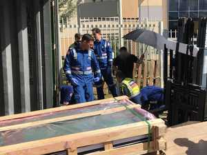 Tradie crushed by falling pallets