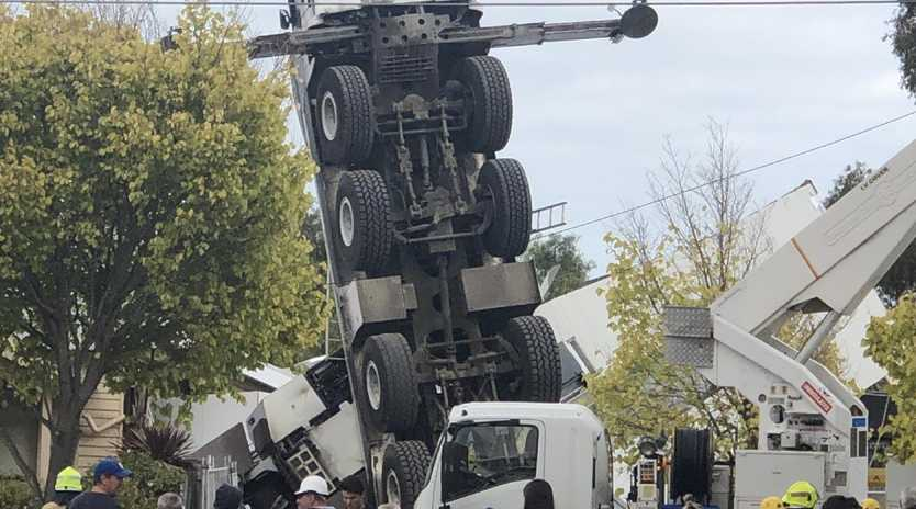 A mobile crane has collapsed onto a house in Yarraville in Melbourne's west.