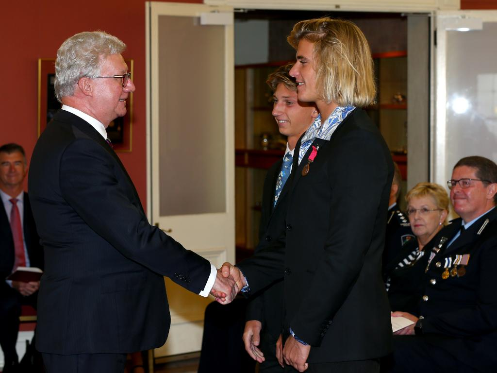 Queensland Governor Paul de Jersey AC presented Bravery Awards this morning at Government House - Best mates Tom Harper (19) and Jae Waters (17) went to the aid of a mate being attacked by a shark at Ballina, Brisbane Tuesday 9th April 2019 Picture AAP/David Clark