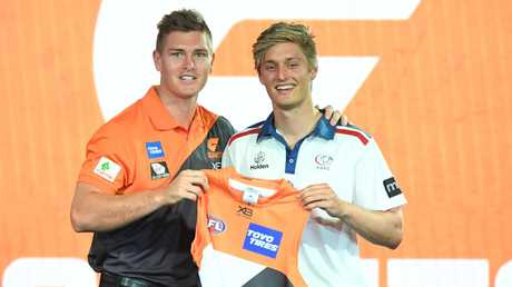 Jackson Hately (right) is pressing for a senior debut with GWS Giants. Picture: AAP Image/James Ross.