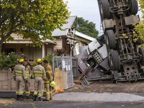 Firefighters assess the scene. Picture: Daniel Pockett/AAP