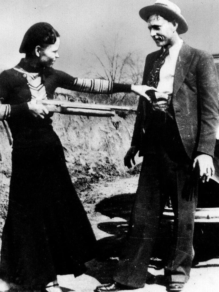 Bonnie and Clyde clown around with shotgun in 1932.