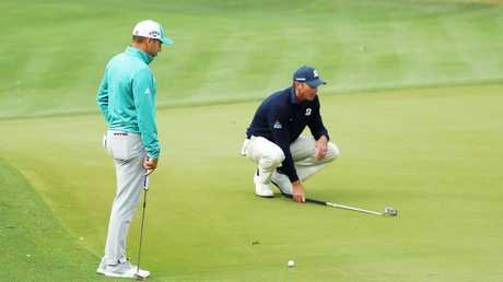 Sergio Garcia looks on as Matt Kuchar lines up a putt at the World Golf Championships Match Play. Picture: Getty