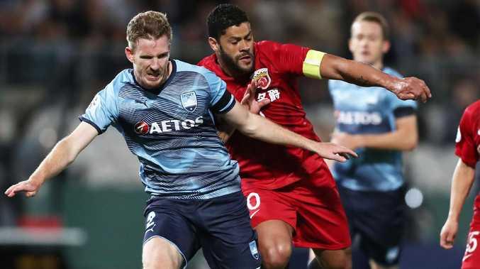 Hulk of Shanghai SIPG shoulders Aaron Calver aside. Picture: Getty