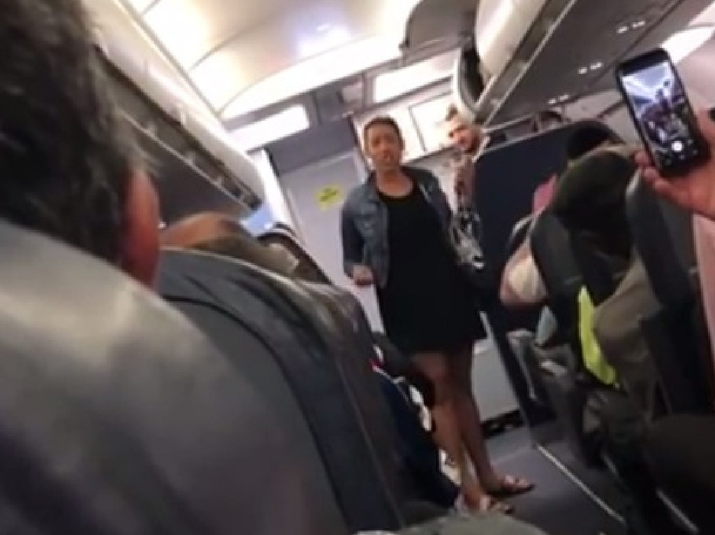 The woman threw a tantrum after being asked to turn off her phone.
