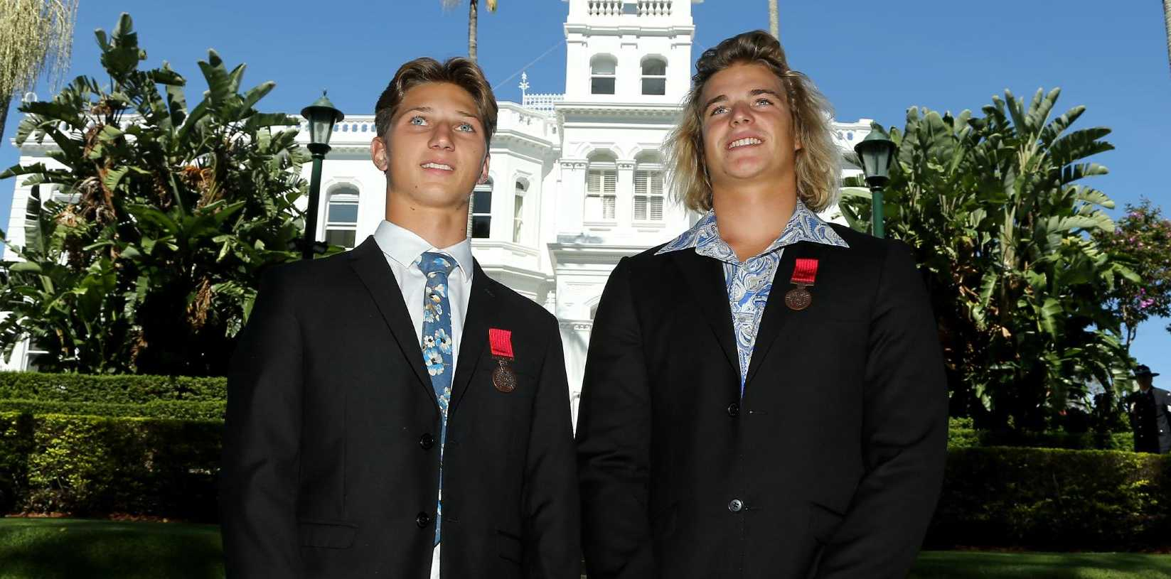 Queensland Governor Paul de Jersey AC yesterday presented Bravery Awards to best mates Tom Harper, 19, and Jae Waters, 17, who went to the aid of a friend being attacked by a shark at Ballina. Picture AAP/David Clark