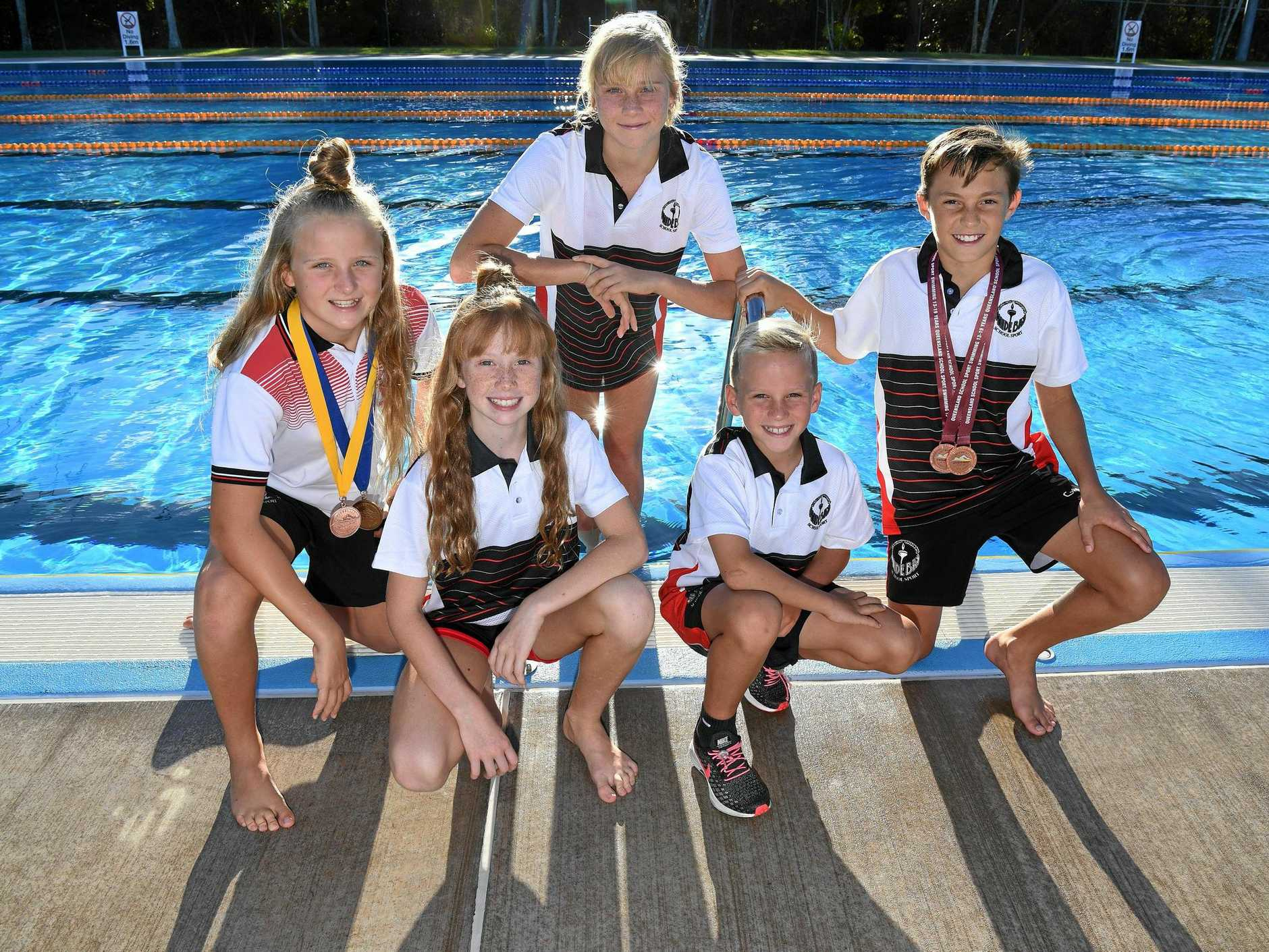 GOING SWIMMINGLY: Kasey Krueger, Indi Bland, Taylar Krueger, Aarj Day and Dehan Pretorius performed strongly at the Queensland State School Swimming Titles in Brisbane.