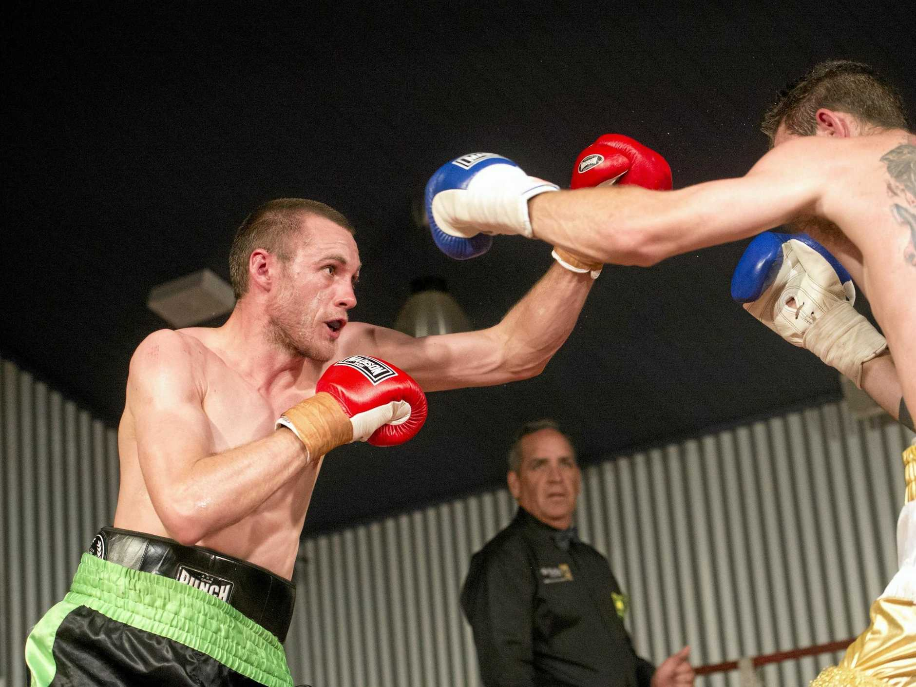 Maks Chylewski (left) mixes it in his last ring appearance with fellow Toowoomba fighter Brent Moore.