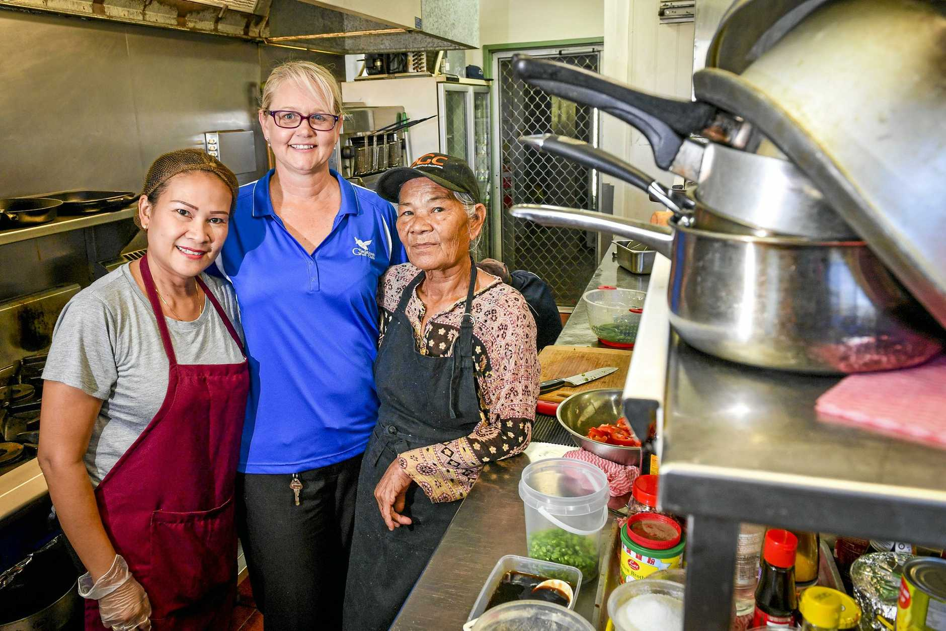 Chavi Dwyer (RIGHT), pictured with golf club manager Lisa Cavanagh and worker Arissaya, is the new chef at Gladstone Golf Club's restaraunt, Thai on the Greens