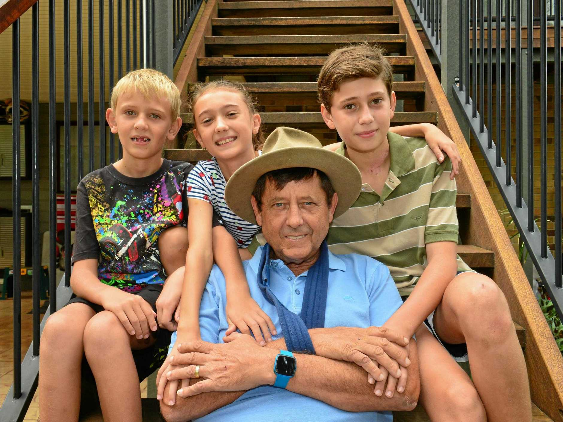 LUCKY TO BE ALIVE: Andrew Carmody and his family Carlo, 13, Ruby, 10 and Roman, 7 back at home in Mudjimba after a head-on crash last week.