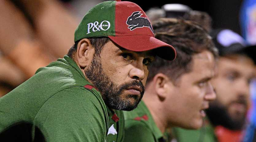 WATCHING ON: Greg Inglis looks on from the bench during the Charity Shield NRL pre-season match.
