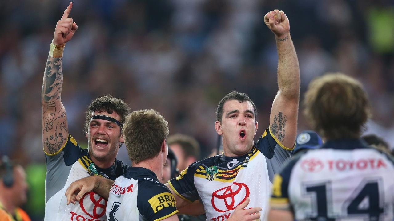 Ethan Lowe, left, celebrates North Queensland's 2015 grand final triumph. Picture: Getty Images