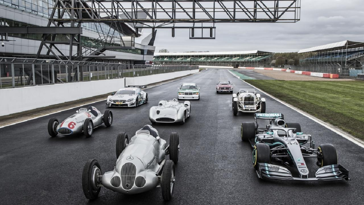 Some of Mercedes' most successful race cars line up on the grid at the Silverstone GP Track in England. Picture: Supplied