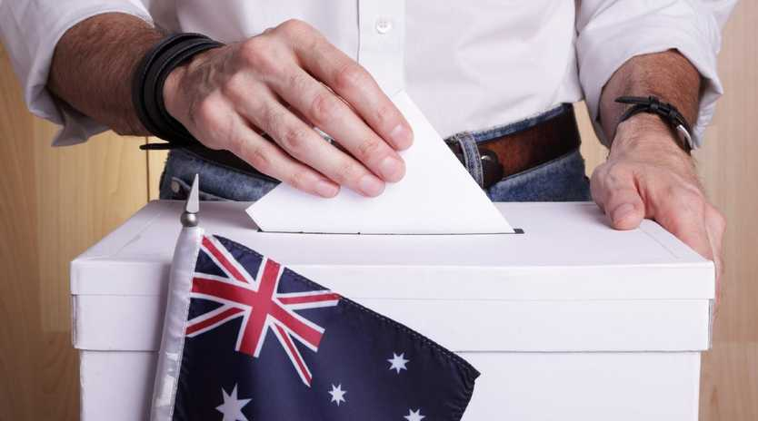 A man inserting a vote to a ballot box.