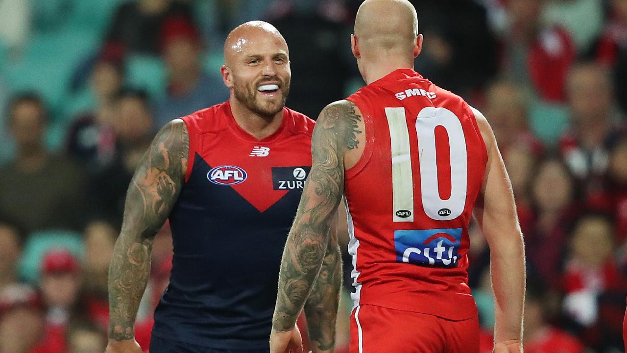 Nathan Jones crosses paths with his brother, Sydney's Zak Jones. Picture. Phil Hillyard
