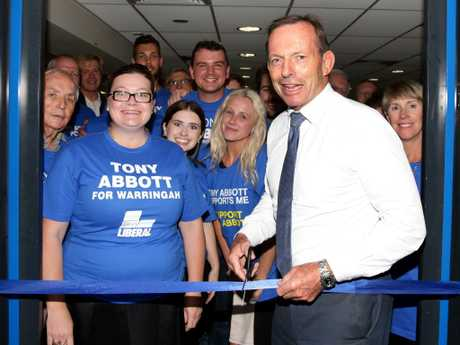 Tony Abbott cutting a ribbon to Brookvale campaign office launch. Picture Jonathan Ng