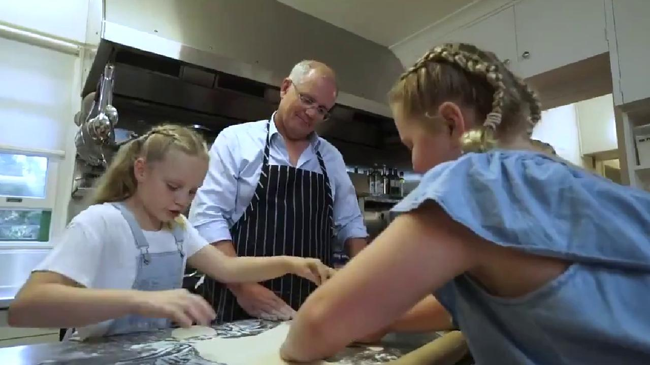 Mr Morrison helps his daugthers in the kitchen. Picture: Twitter video
