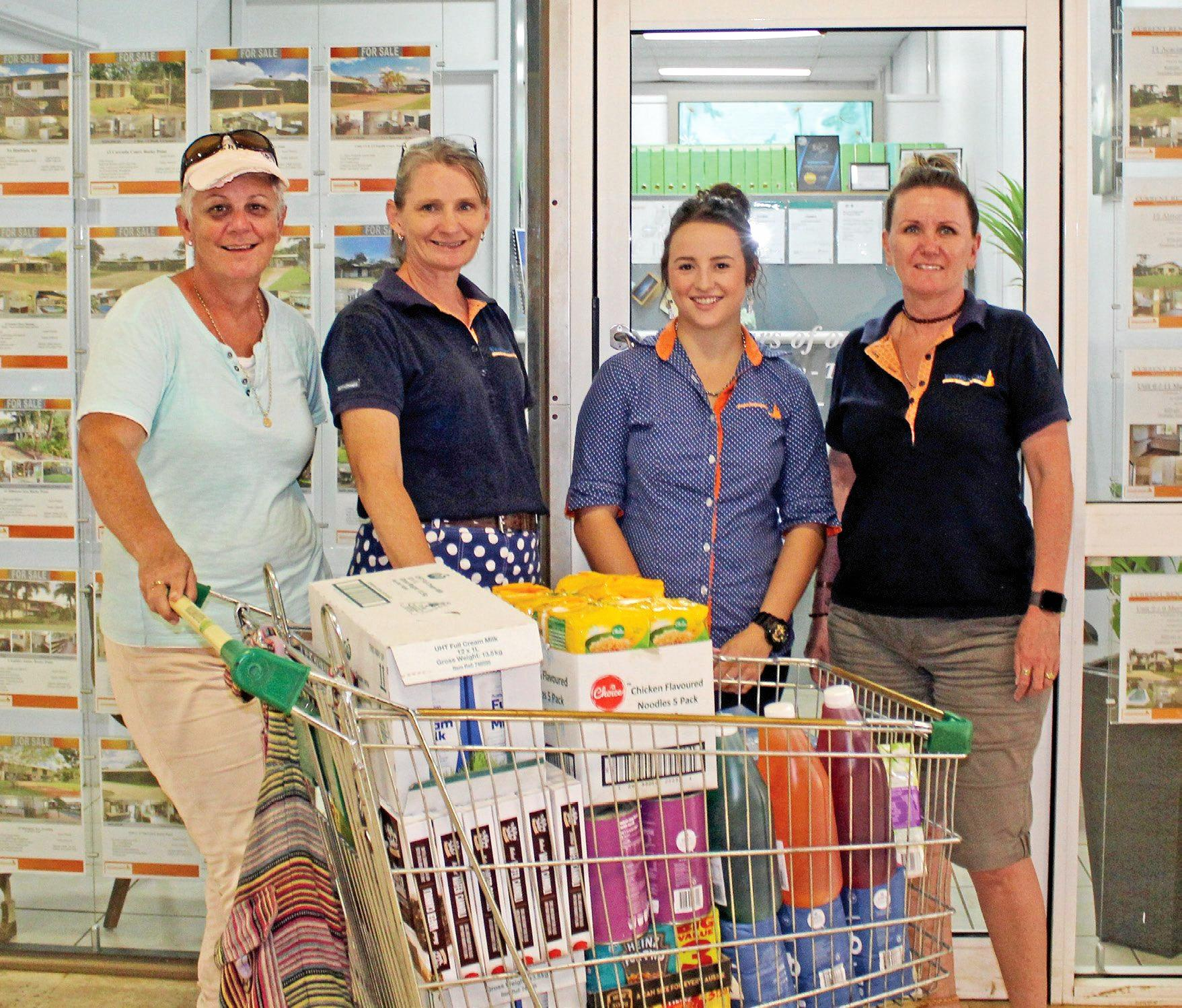 With some donations are (from left) Jane English with Sandy Aldcroft, Shayna Reeves and Helen Vanbrugh of Western Cape Real Estate.