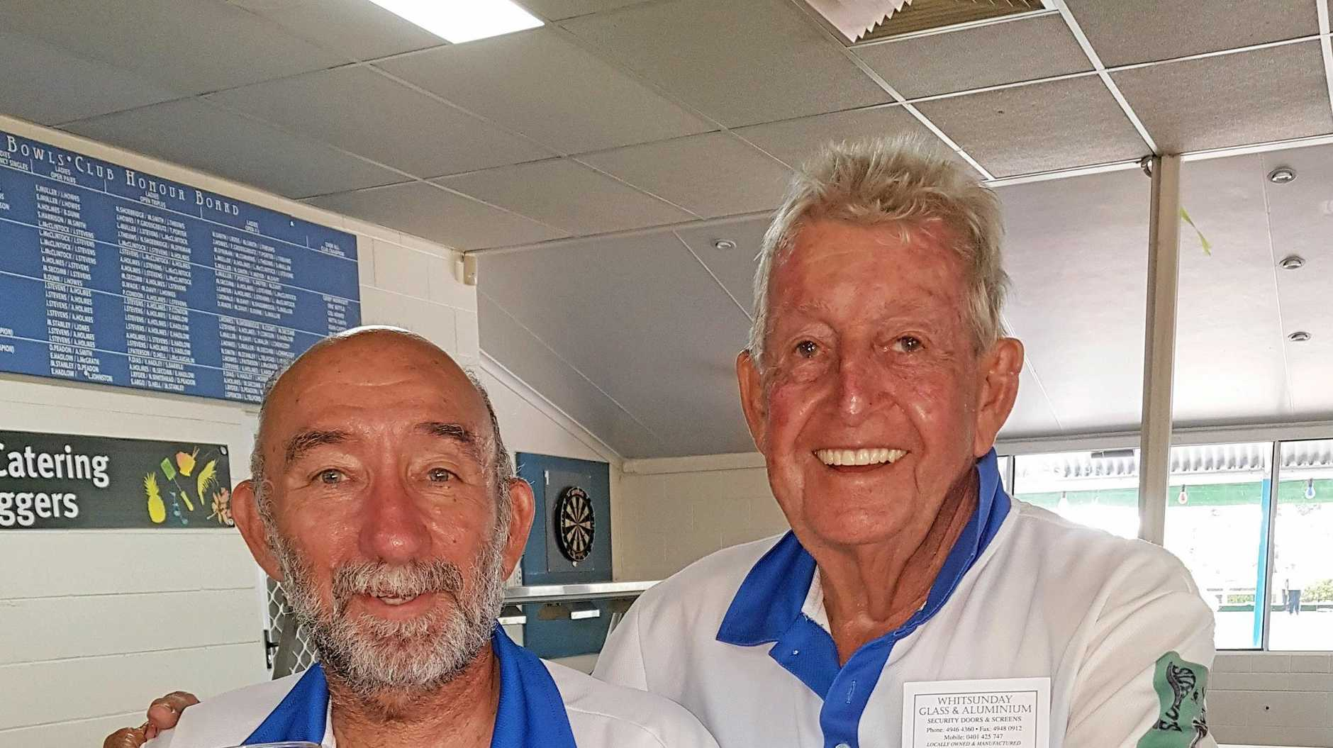 TOP RESULT: Russ Jackson and Rick Brunell celebrate their win at Airlie Beach last Sunday with a post-match beer.