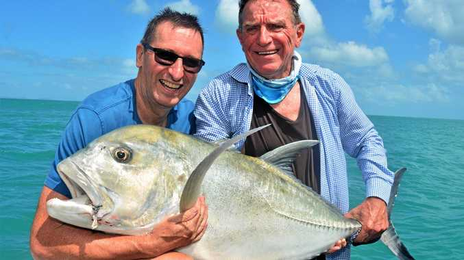 QUITE A HANDFUL: Pastors John Gardner (left) and Warren McMartin with a hefty giant trevally.
