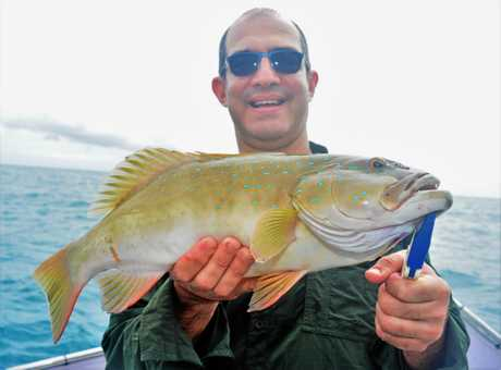Paul Perrin of Auto Pro Cannonvale with a nice coral trout.