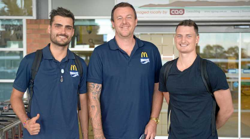 READY TO GO: Rockhampton Basketball manager Cameron Tragardh (centre) welcomes players Jimmy Mitchell and Shaun Bruce to the city on Wednesday.