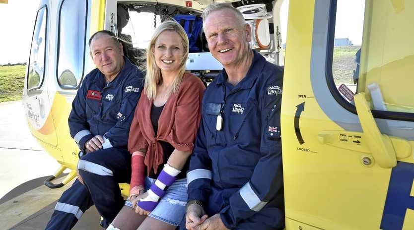 REUNION: Catching up at the Toowoomba LifeFlight base yesterday are (from left) Anthony Connolly, Tiffany Thompson - who was helped by LifeFlight last month - and Dave Hampshire.