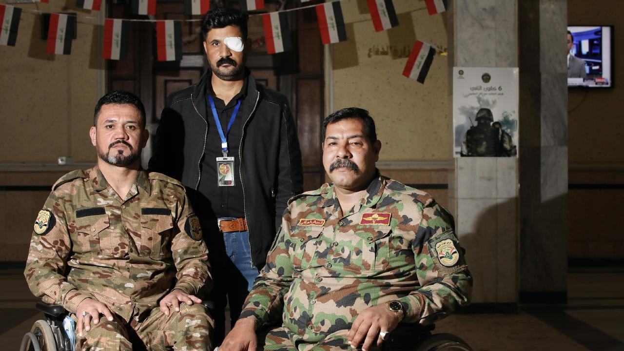 Abdul Sahib Ridha, 37, Maithem Slaiyill, 35, and Nabeal Sabah, 41 at the Ministry of Defence. They are members of Voice of Righteousness, a disable veterans group. Picture: Ella Pellegrini