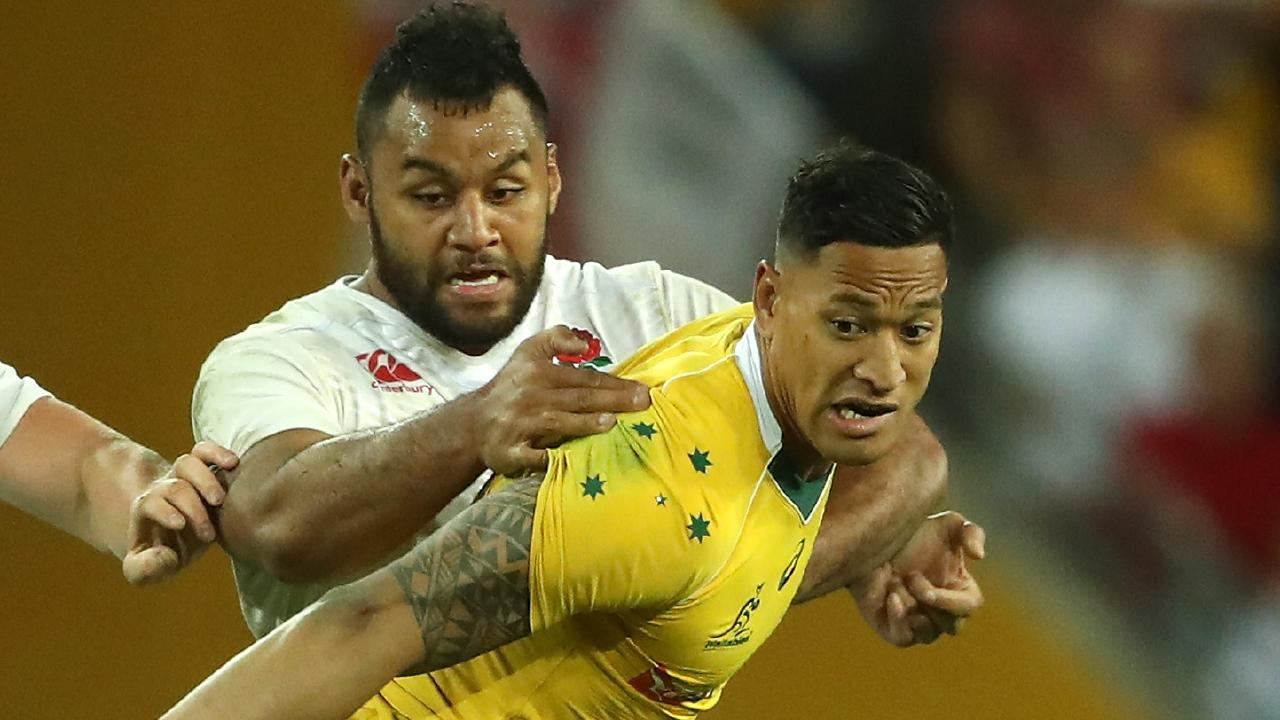 Israel Folau of Australia is held by Billy Vunipola at Suncorp Stadium. Picture: Getty Images