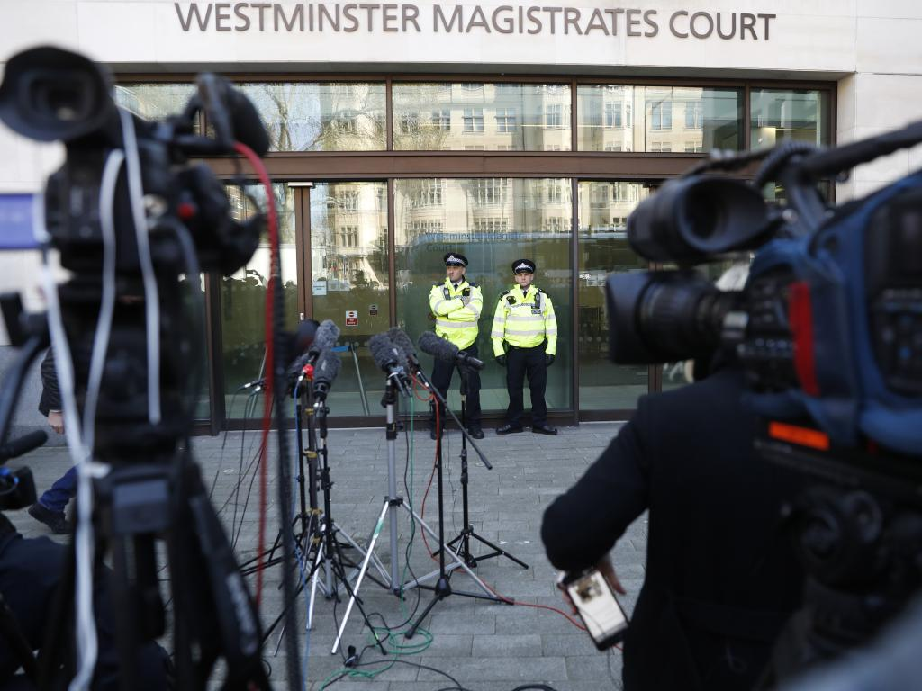 Police stand guard outside Westminster magistrates court where WikiLeaks founder Julian Assange appearied in London, Thursday, April 11, 2019. Picture: AP Photo/Alastair Grant