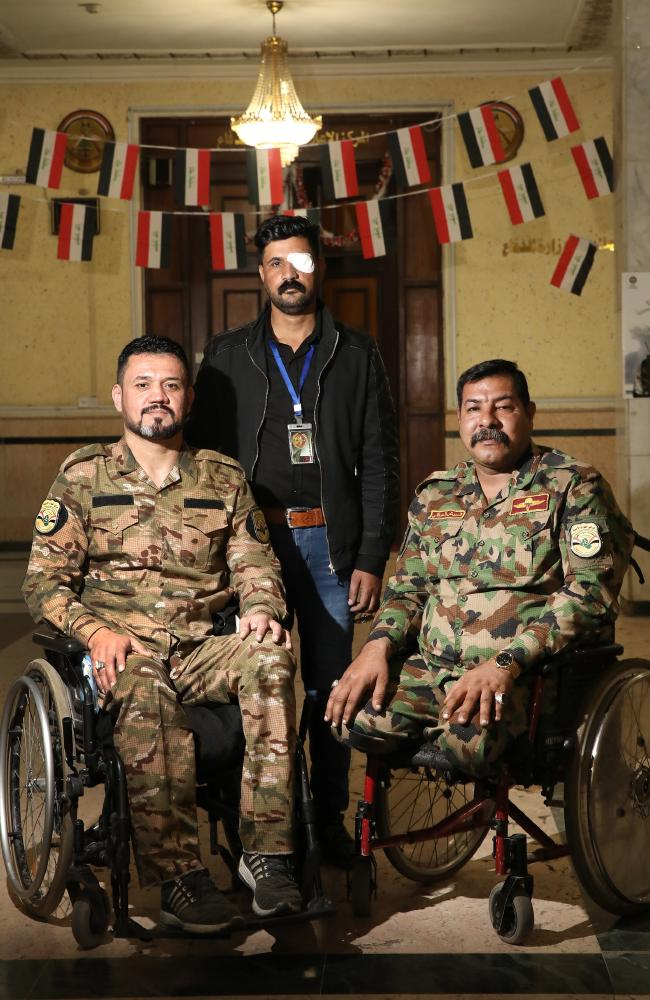 Abdul Sahib Ridha, 37, Maithem Slaiyill, 35, and Nabeal Sabah, 41 at the Ministry of Defence. They are members of Voice of Righteousness, a disabled veterans group. Picture: Ella Pellegrini