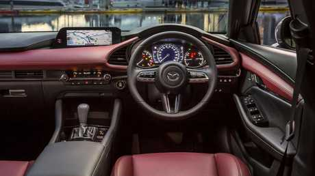 Mazda is ditching touchscreens with its centre display controlled by a rotary-style dial.