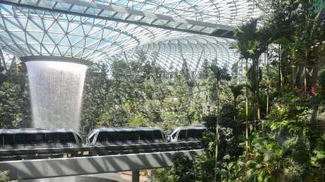 The skytrain runs inside Jewel.
