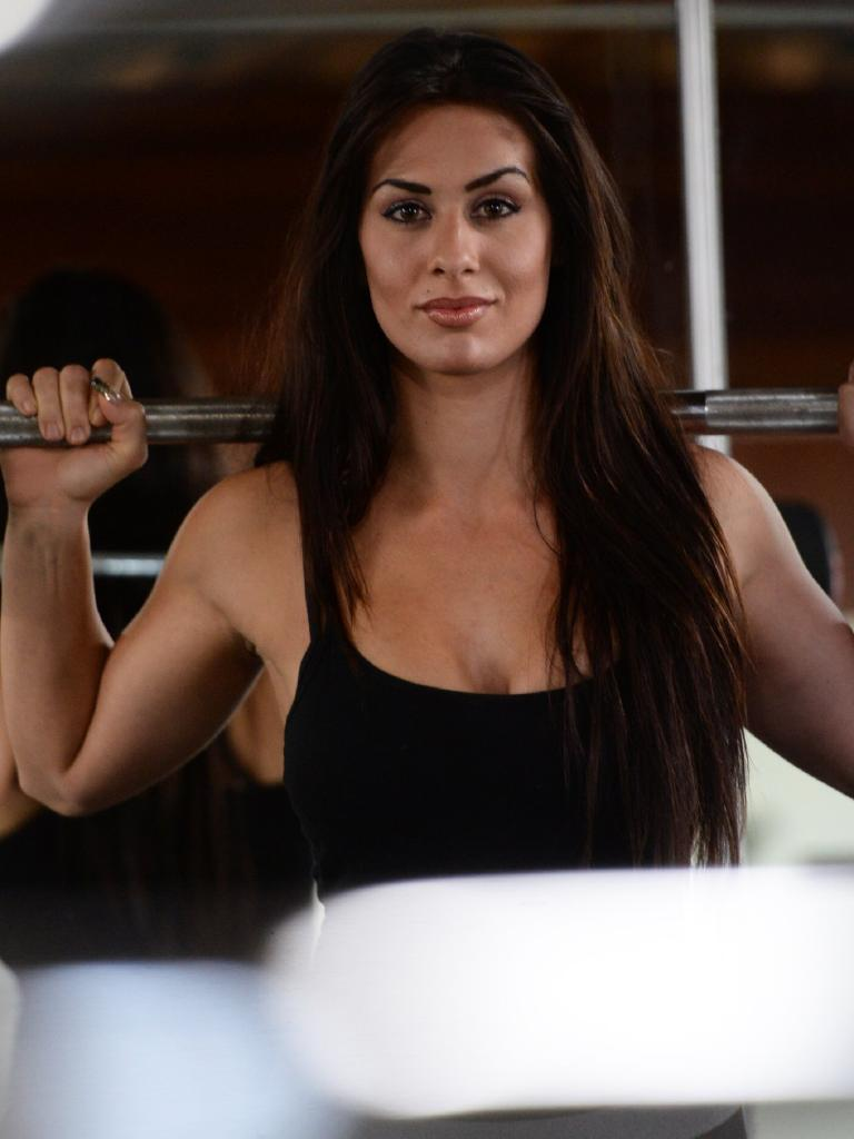 Bodybuilder and bikini model Courtney Barbera working out. Courtney was runner-up in the Italy World Bikini Fitness and Fashion Inc in 2018 and was a director of Barbera Farms. Photo: Mike Knott / NewsMail