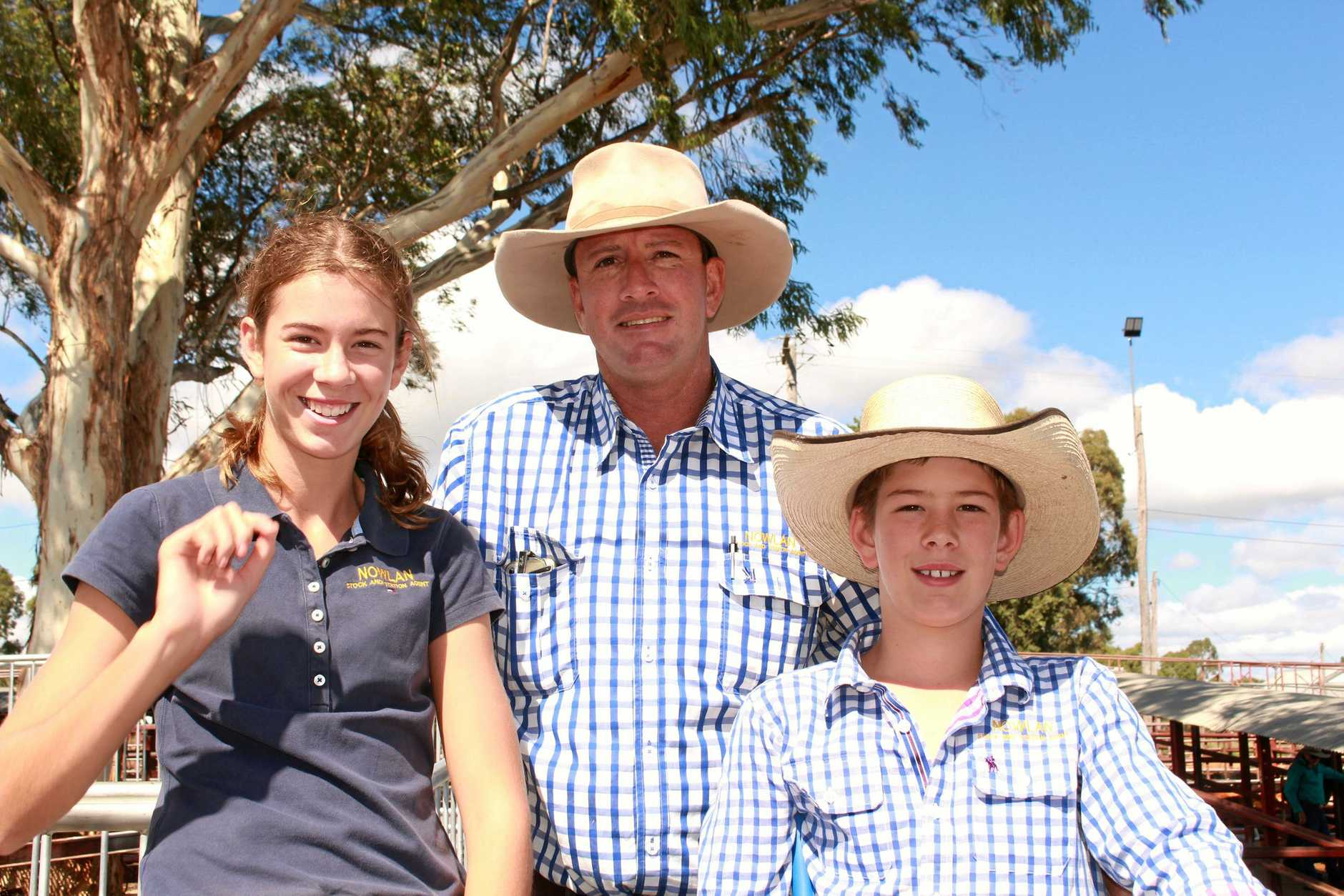 FAMILY TIME: Matilda, Michael and Innes Nowlan have been working hard to prepare for the annual weaner sale and were glad to see success with 480 head of cattle sold to new homes.