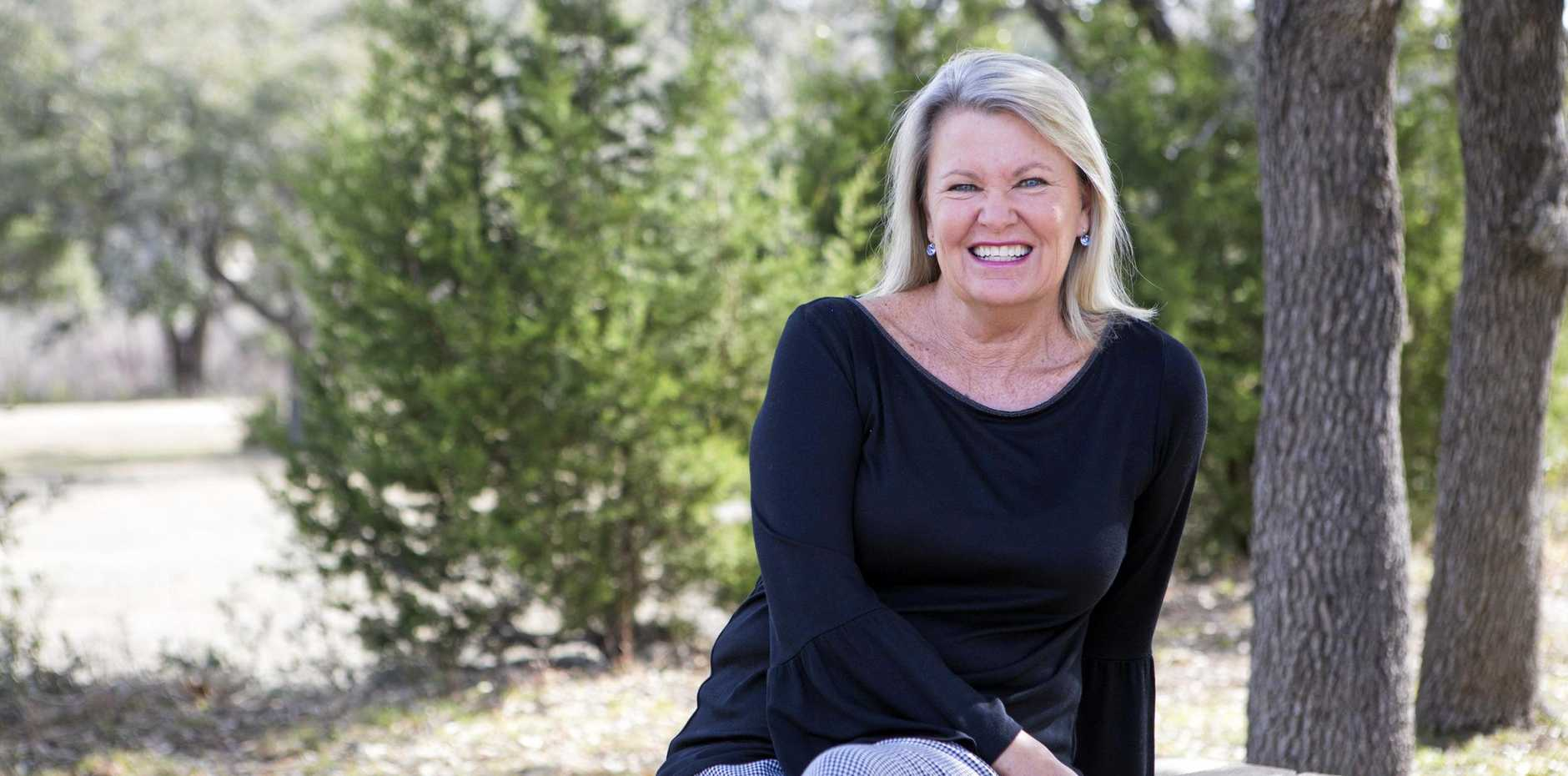 MUM ON THE RUN: Lee Barnett, who eluded the FBI for two decades before her secret life in Queensland was revealed, has written a memoir titled  A Mother's Promise  (inset).