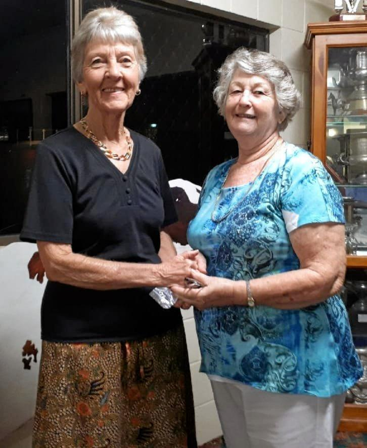 Thelma Myers is congratulated by Chief Steward for the Gympie Show Cookery section, Anne Long, for her many years of dedicated service to The Gympie Show.