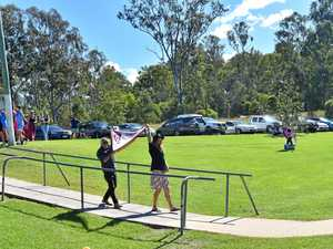Gympie Cats unfurl Flag