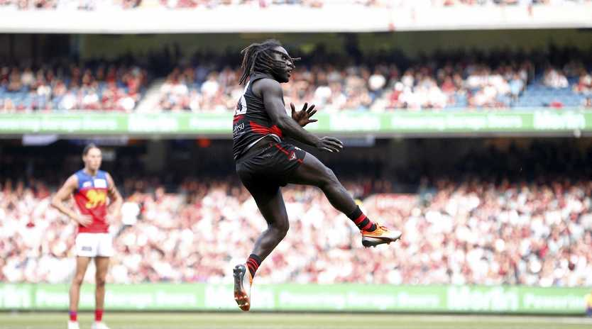 Essendon's Anthony McDonald-Tipungwuti kicks a goal against the Brisbane Lions at the MCG on Saturday.