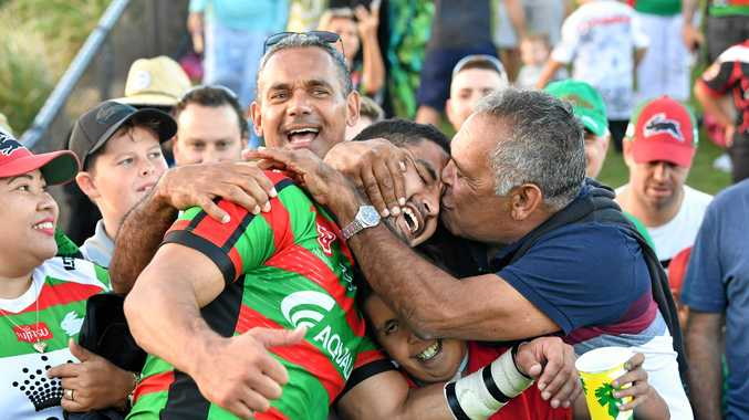 Cody Walker is kissed by his father Bernie after the Rabbitohs' win over the Warriors at Sunshine Coast Stadium.