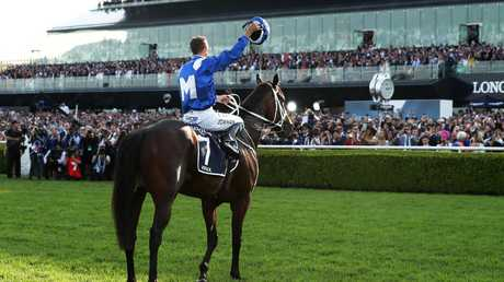 Hugh Bowman waves to the crowd after Winx's 33rd straight victory. Picture: Getty Images
