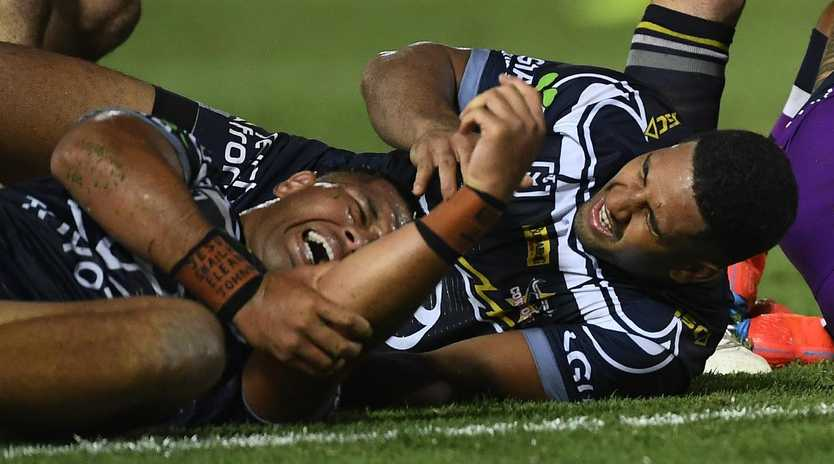 John Asiata and Nene MacDonald on the Townsville turf in pain. Picture: Ian Hitchcock/Getty Images