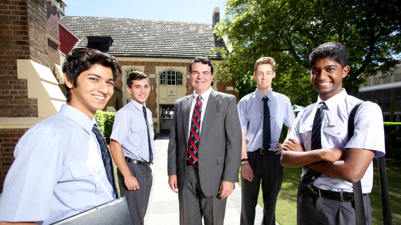 Brisbane Grammar School headmaster Anthony Micallef (centre) with (from left) students Ryan Hua, 16, Daniel Athanasellis, 17, Toby Taylor, 17, and Saravanan Somasundaram, 17. Picture: AAP/Steve Pohlner