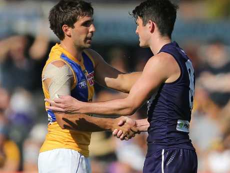 Andrew Gaff of the Eagles and Andrew Brayshaw shook hands before the first bounce.