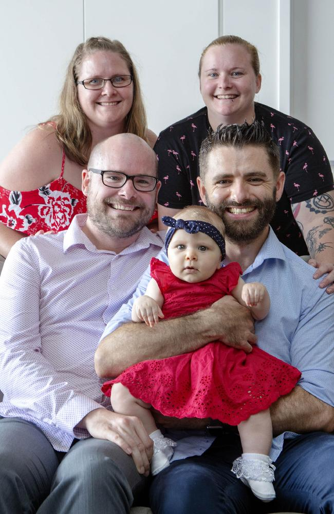 Stanley and Marco Oliveira-Gray (front left-right) are now fathers to a beautiful little Annabelle, with the help of Stan's sisters Louise Appleton (top left) and Amanda Gray. (AAP/Image Sarah Marshall)