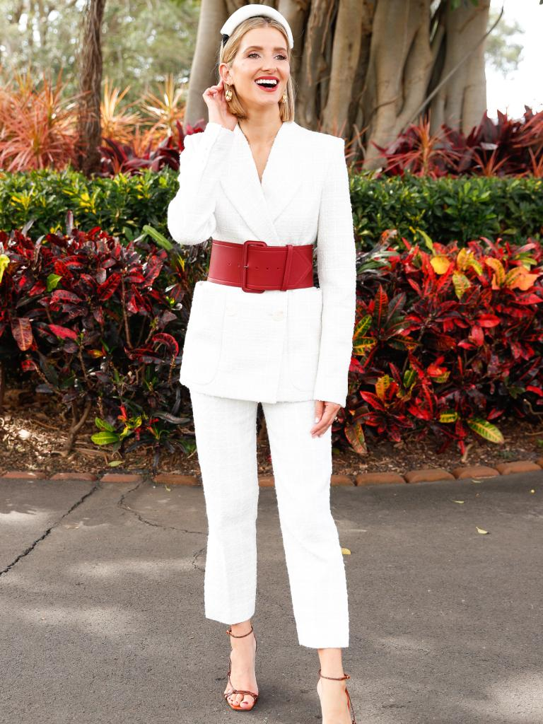 2019 Longines Queen Elizabeth Stakes Ambassador, Kate Waterhouse wore a white suit with a bold red belt.
