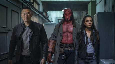 Daniel Dae Kim, David Harbour and Sasha Lane in a scene from Hellboy.