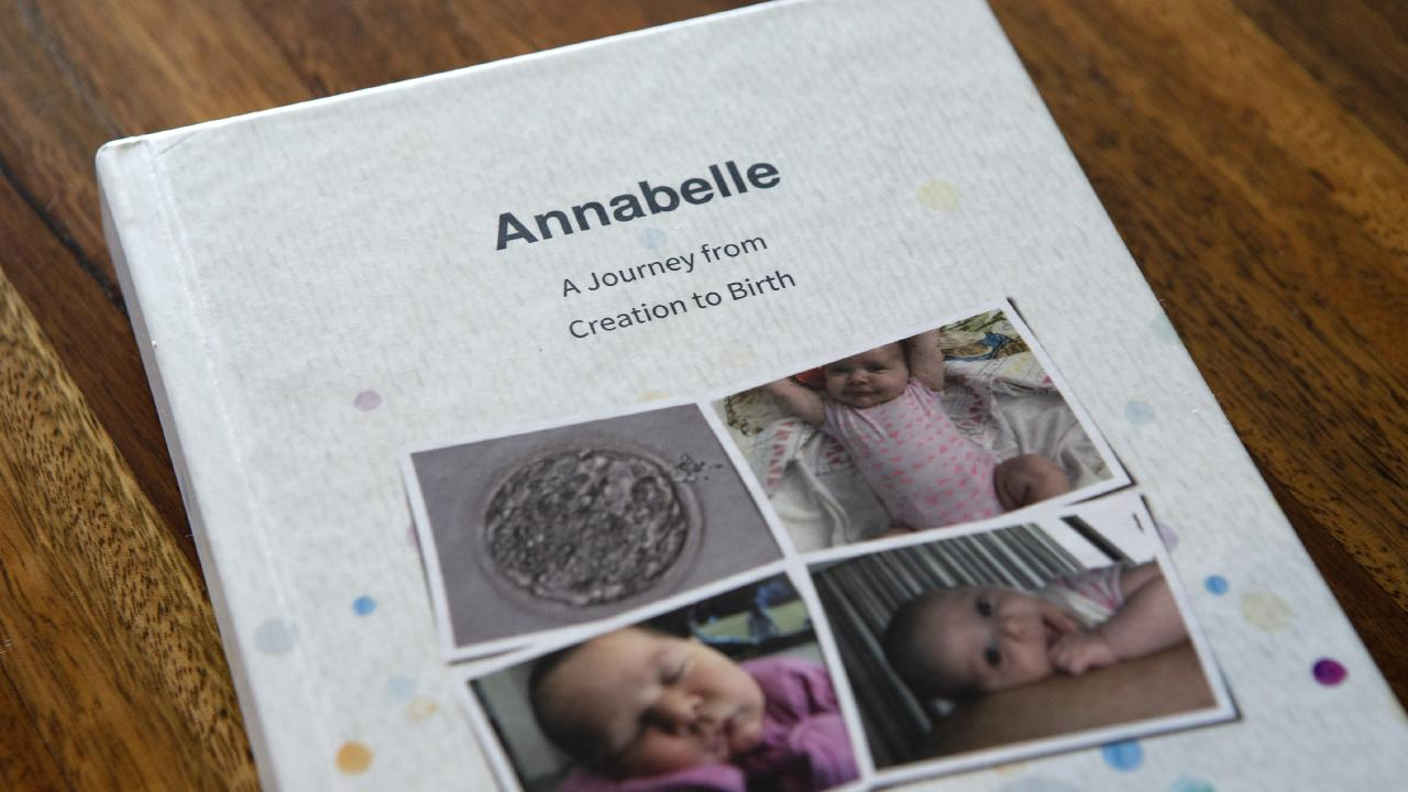 The book Stanley and Marco Oliveira-Gray had printed of the group's two year Facebook group chat during the surrogacy process before and after seven month old Annabelle was born.