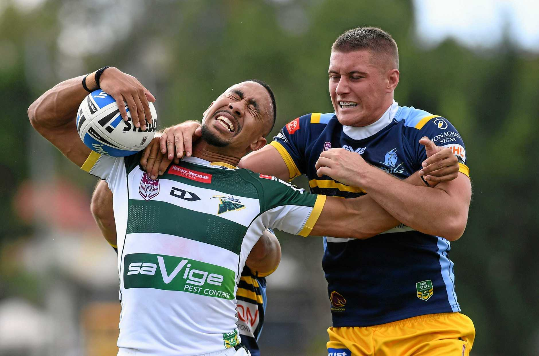 Jets halfback Julian Christian gets grabbed by the Norths tackler in today's game.