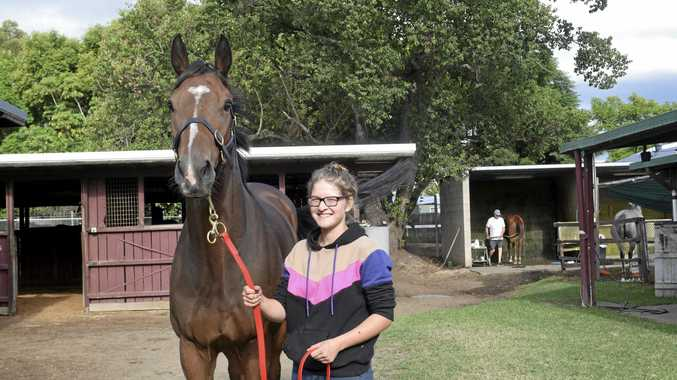 IN FORM: John Shelton-trained three-year-old Wotsizname with stablehand Candice Woodhouse.